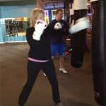 woman boxing heavybag drills