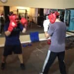 two amateur boxing students sparring